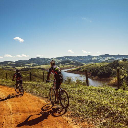 cyclists-trail-bike-clouds-163407